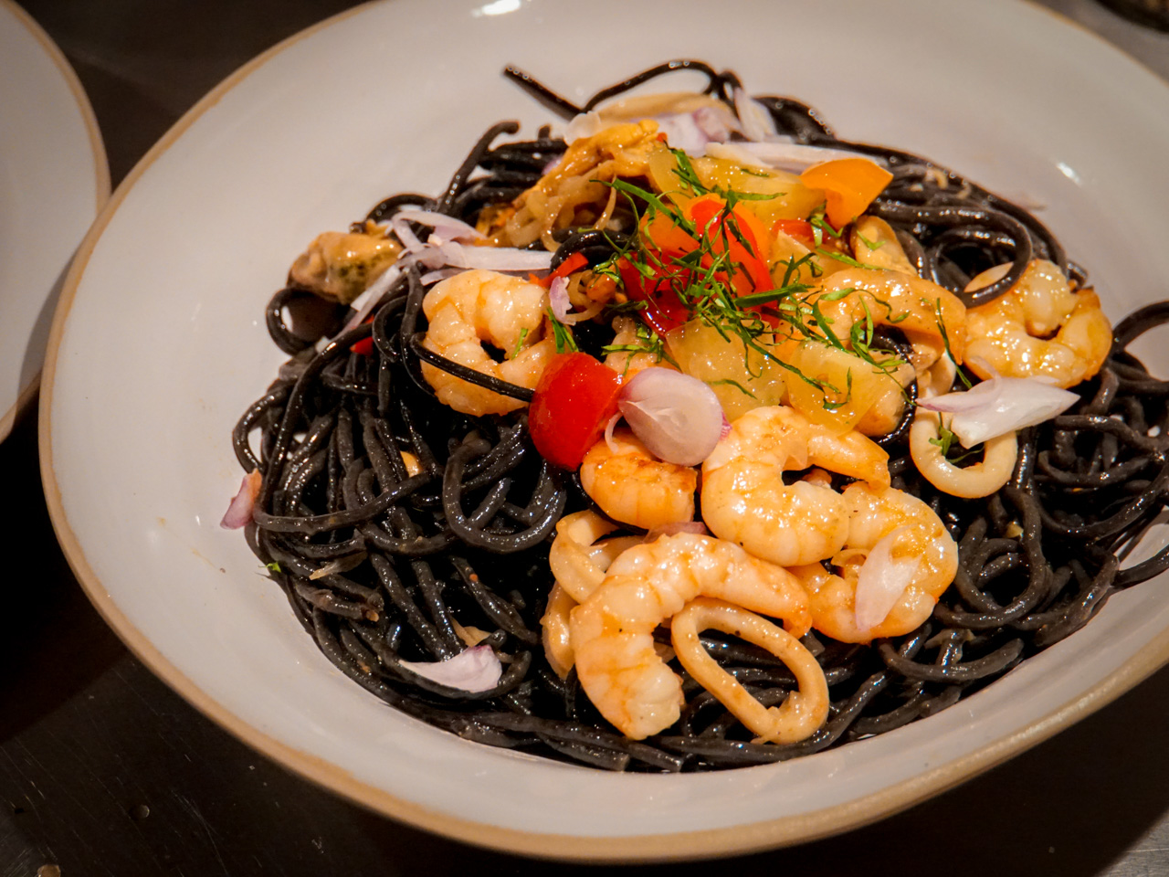 Squid-ink spaghetti with seafood cooked with lemongrass