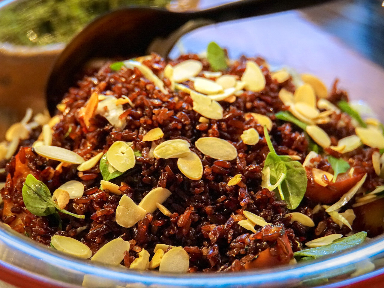 Red Camargue rice with almond flakes
