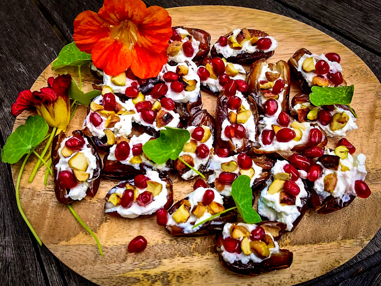 Dates with goats cheese, pistachio & pomegranates